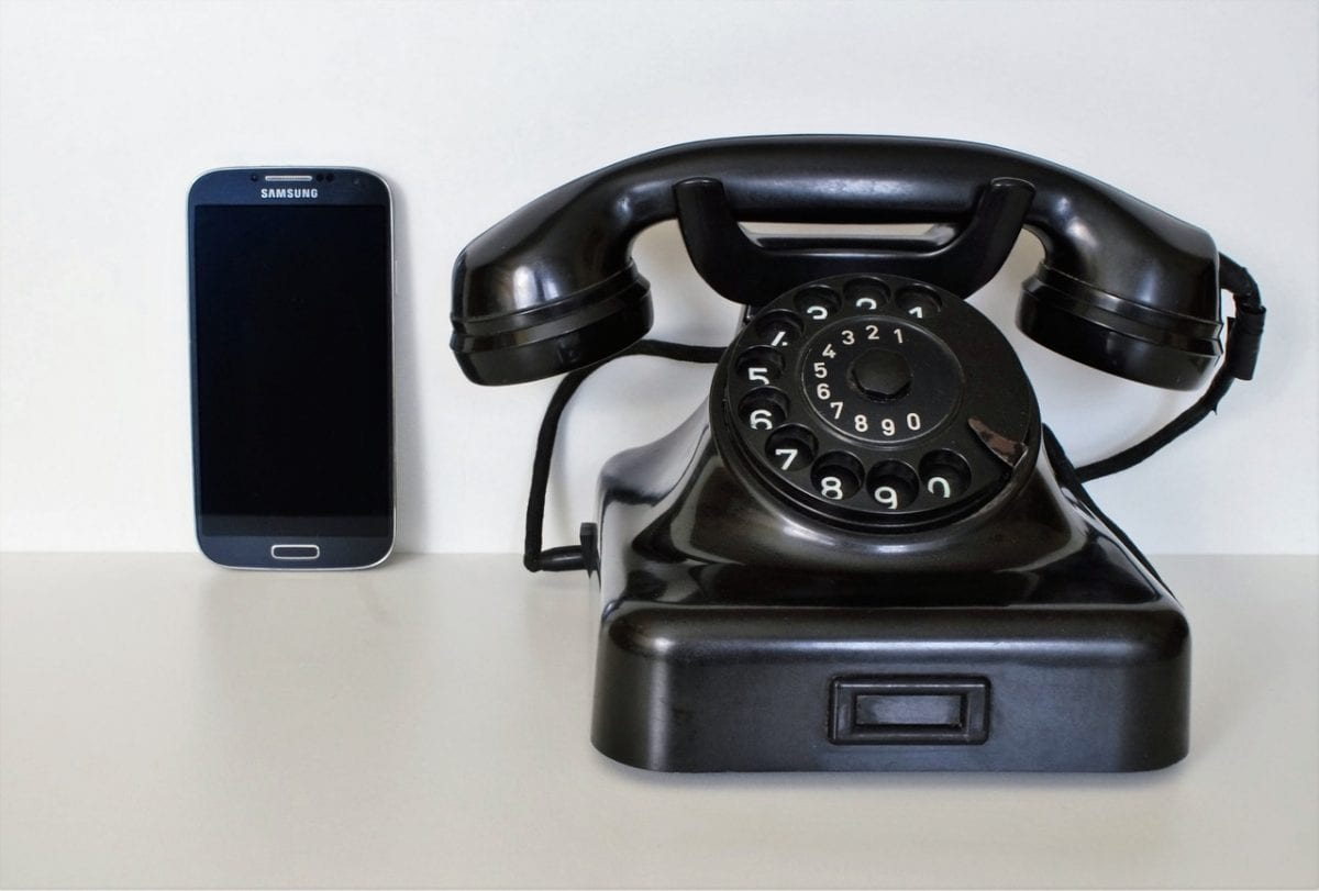 old fashioned phone next to mobile