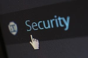 computer cursor pointing at the word security