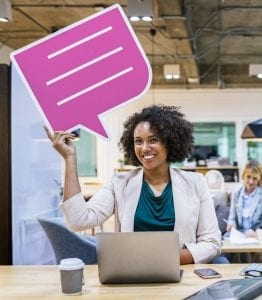 smiling woman holding pink and white chat bubble chatbots and gdpr