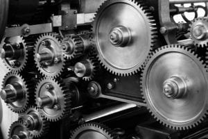 black and white close up of cogs and gears