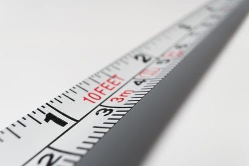 close up of measuring tape customer experience metrics